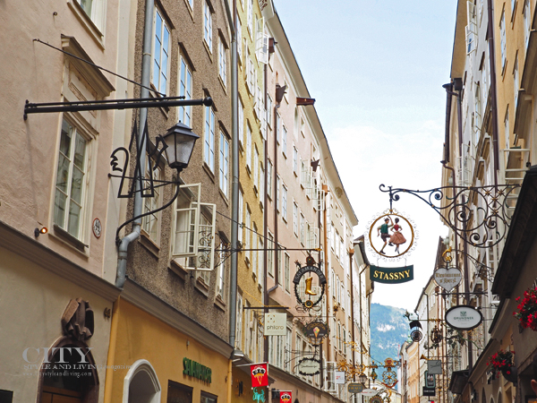 Wrought iron signs on the Getreidegasse in Salzburg Austria