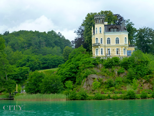 A beautiful house graces lake Woerthersee near Klagenfurt Austria