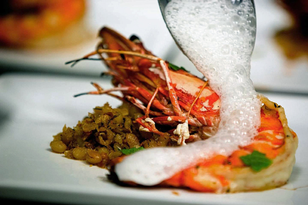 A prawn dish gets a final touch at Venue restaurant in Lincoln.