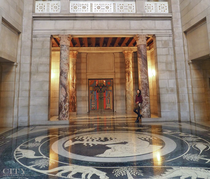 The rotunda marble mosaic floor and marble columns inside the Nebraska state capitol