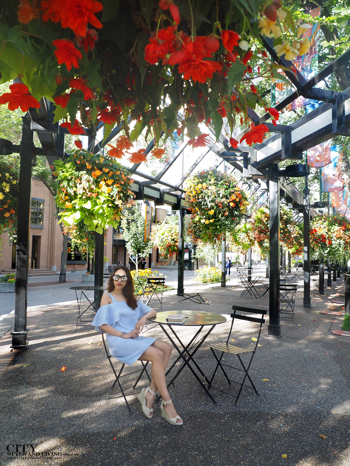 City STyle and Living The Editors Notebook style blogger Downtown Calgary colourful flowers blooming during summer wearing an off shoulder topshop dress and wedges sitting