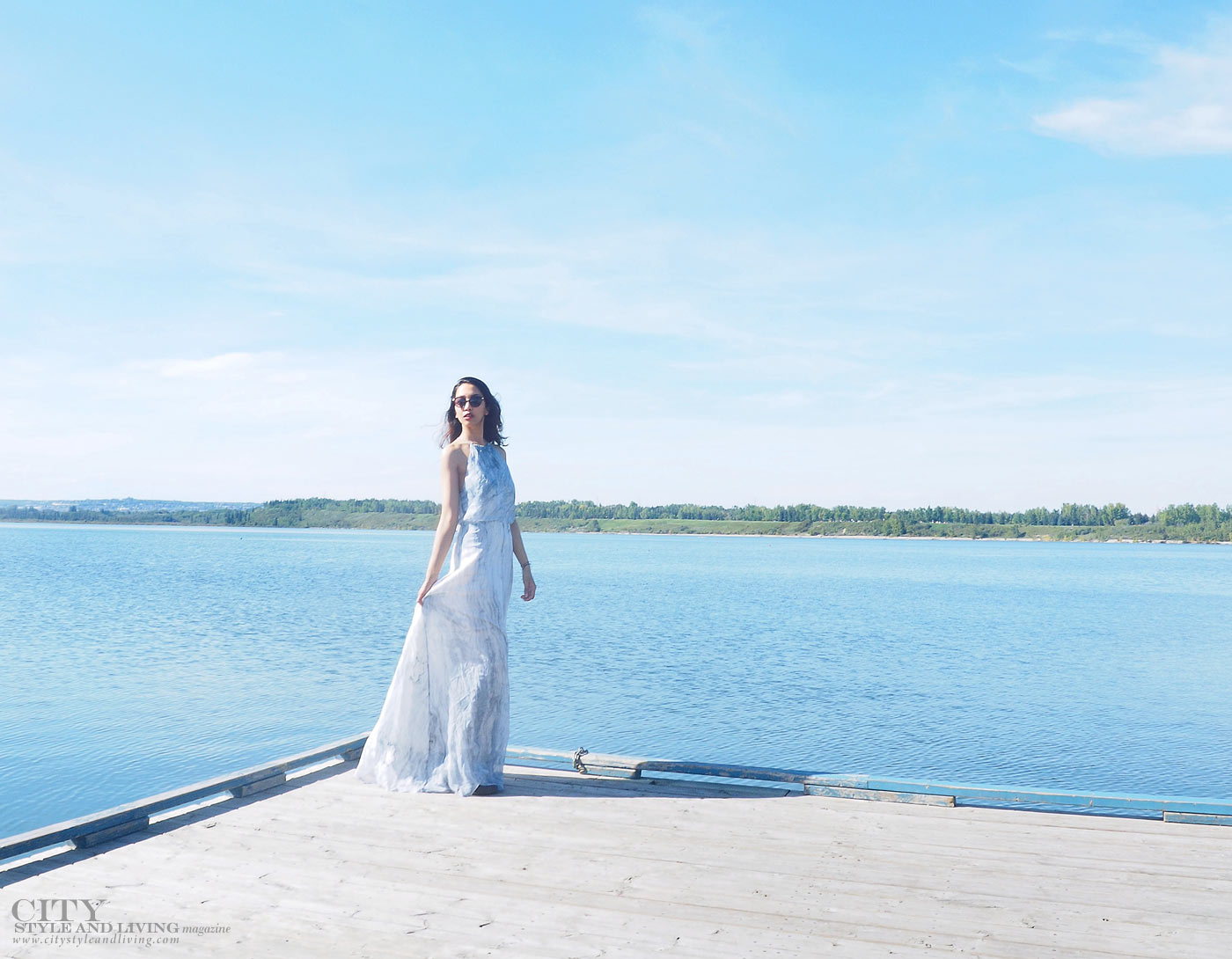 The Editors Notebook calgary fashion blogger wearing a maxi dress at glenmore resevoir boardwalk walking