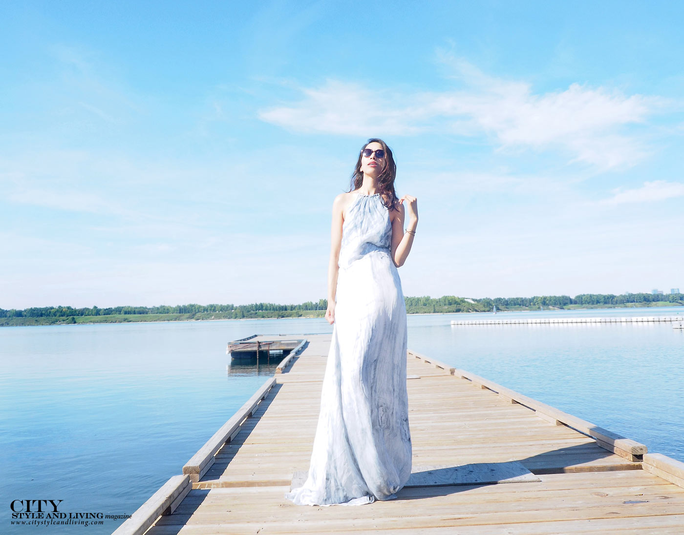 The Editors Notebook calgary fashion blogger wearing a maxi dress at glenmore resevoir boardwalk closeup