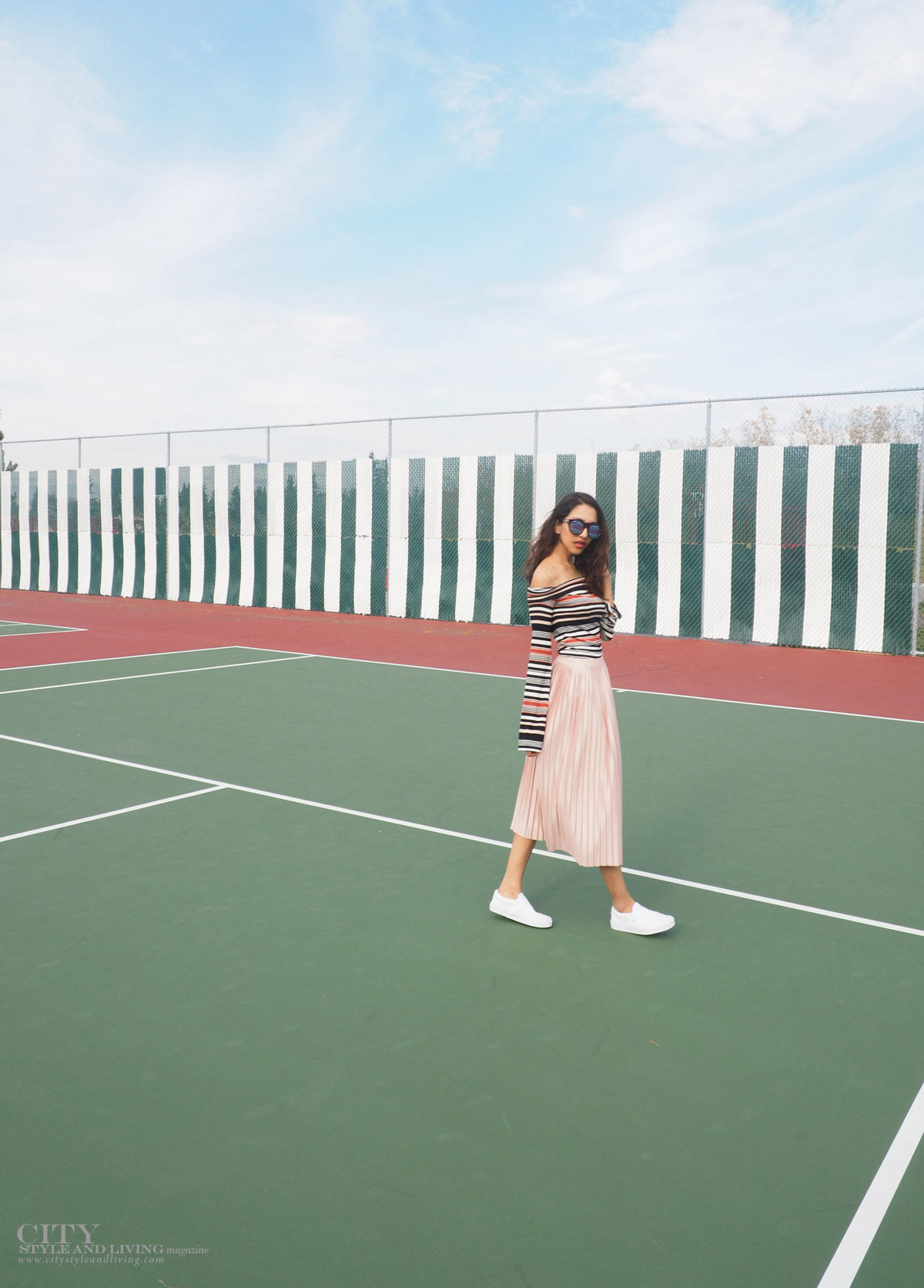 City STyle and Living The Editors Notebook style blogger tennis court topshop metallic skirt, off shoulder free people top, le specs sunglasses and white sneakers and topshop bomber jacket walking on court