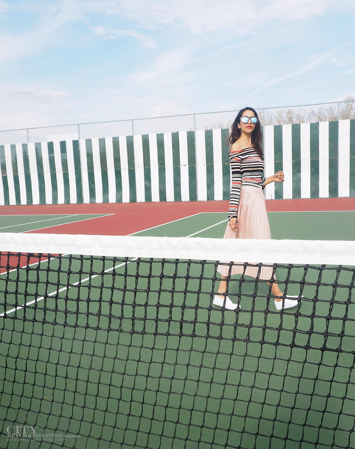 City STyle and Living The Editors Notebook style blogger tennis court topshop metallic skirt, off shoulder free people top, le specs sunglasses and white sneakers walking by net