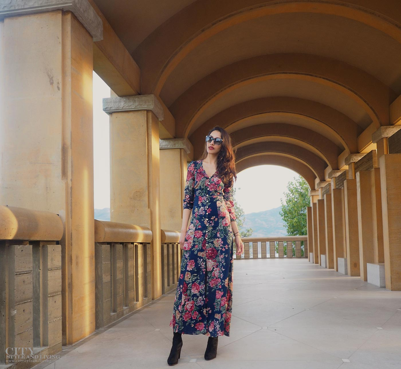 The Editors Notebook style blogger at Mission Hill family estate winery at sunset wearing ralph lauren maxi dress and sam edelman thigh high boots closeup