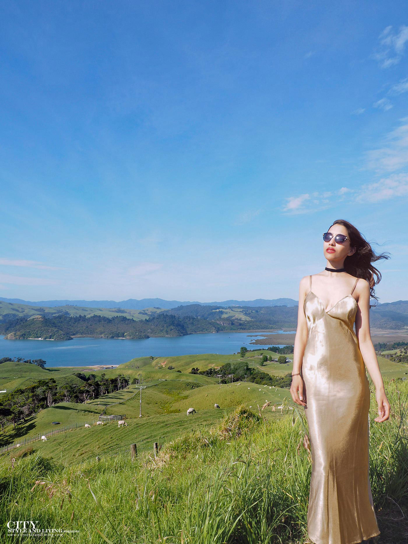 City style and living magazine Editors Notebook style fashion blogger Shivana M Mercury Bay Winery Coromandel New Zealand Gold dress overlooking the ocean