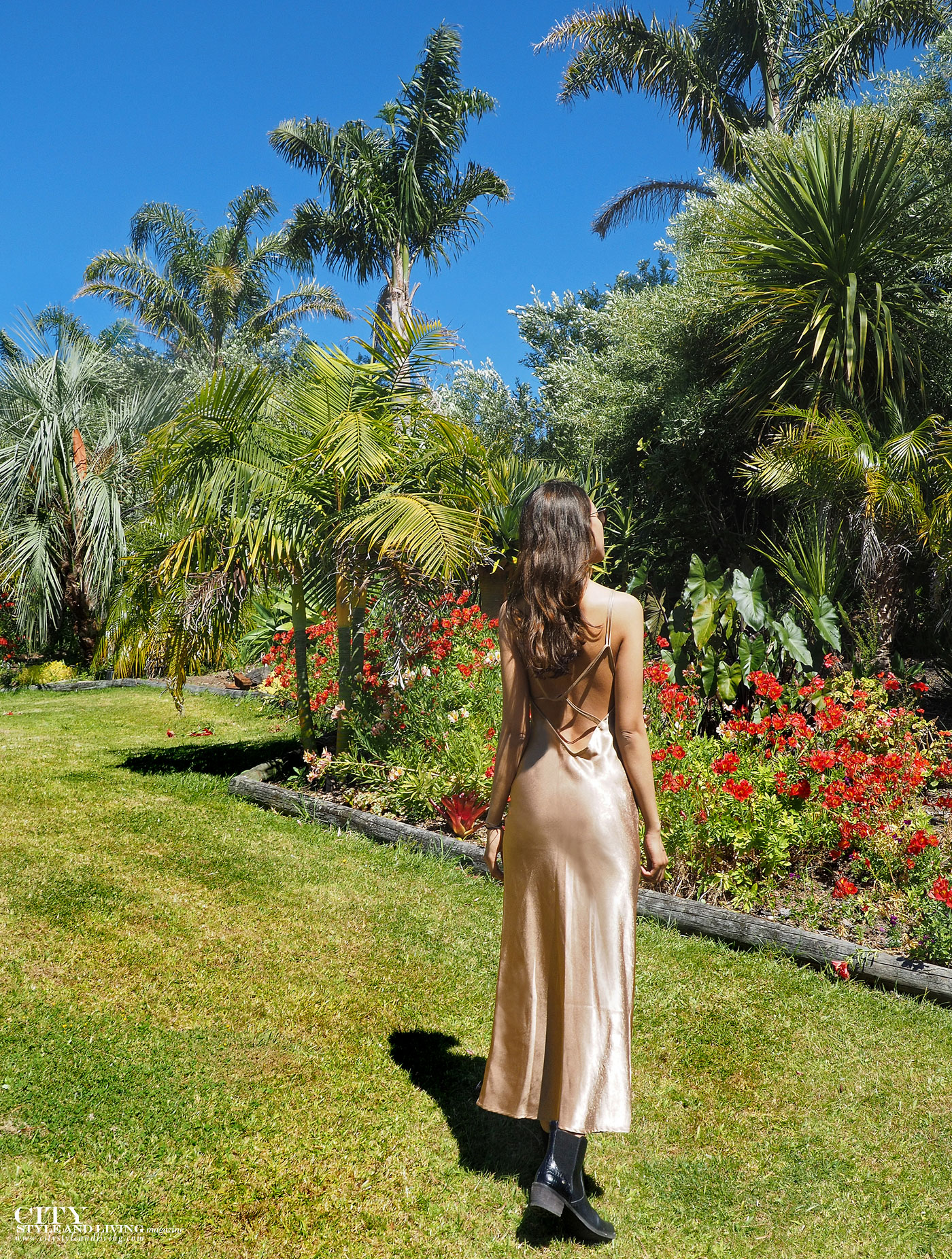 City style and living magazine Editors Notebook style fashion blogger Shivana M Mercury Bay Winery Coromandel New Zealand Gold dress in garden back