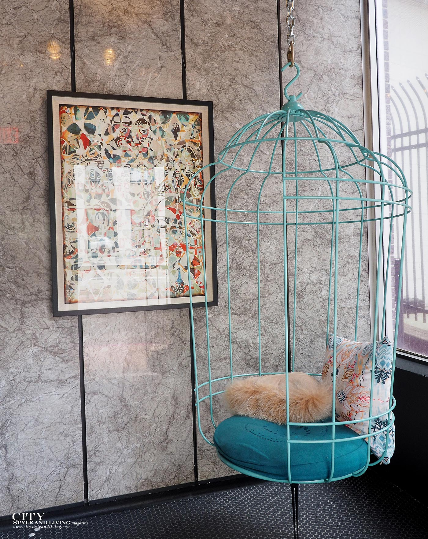 City Style and Living Moxy New Orleans birdcage at entrance