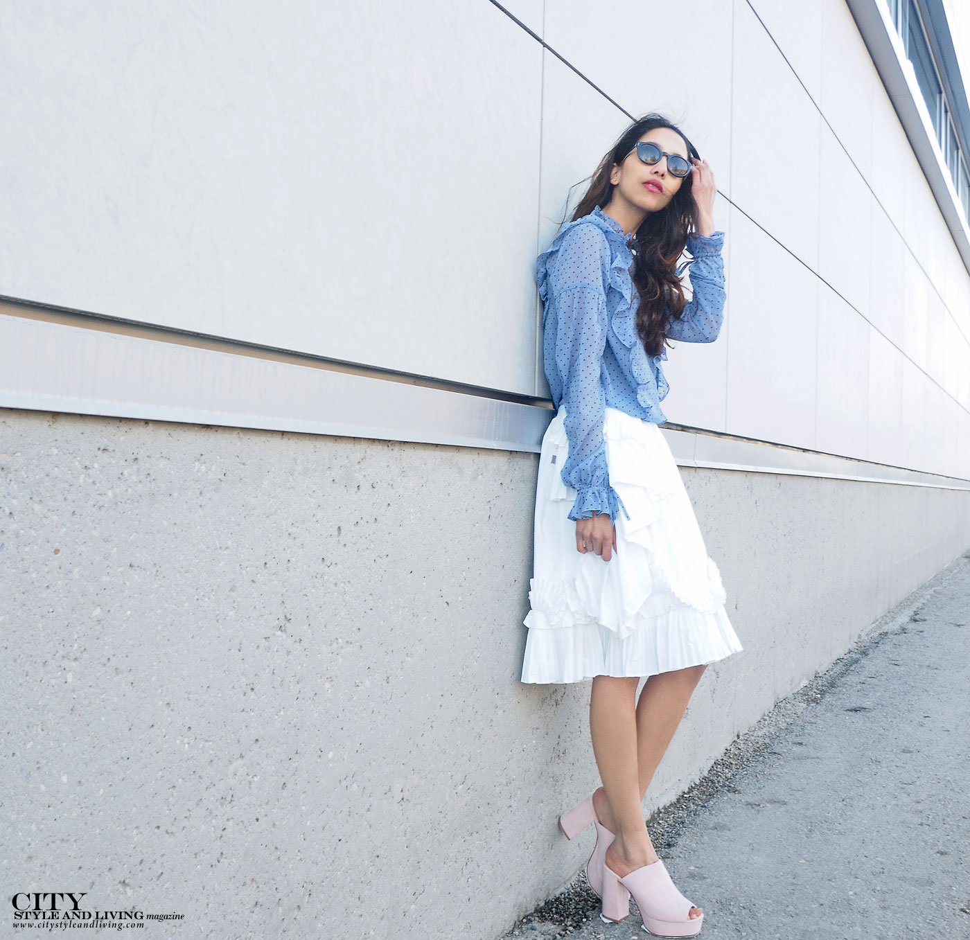 City style and living magazine The Editors Notebook style fashion blogger Shivana Maharaj how to wear frills for spring 2017 standing by wall