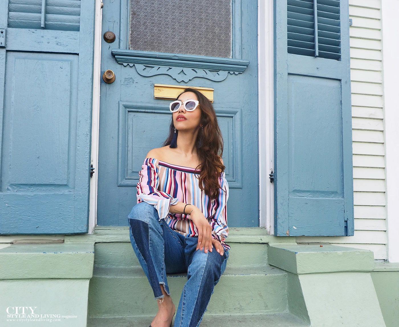 City style and living magazine The Editors Notebook style fashion blogger Shivana Maharaj New Orleans French Quarter Off shoulder top and ankle biter jeans sitting on steps