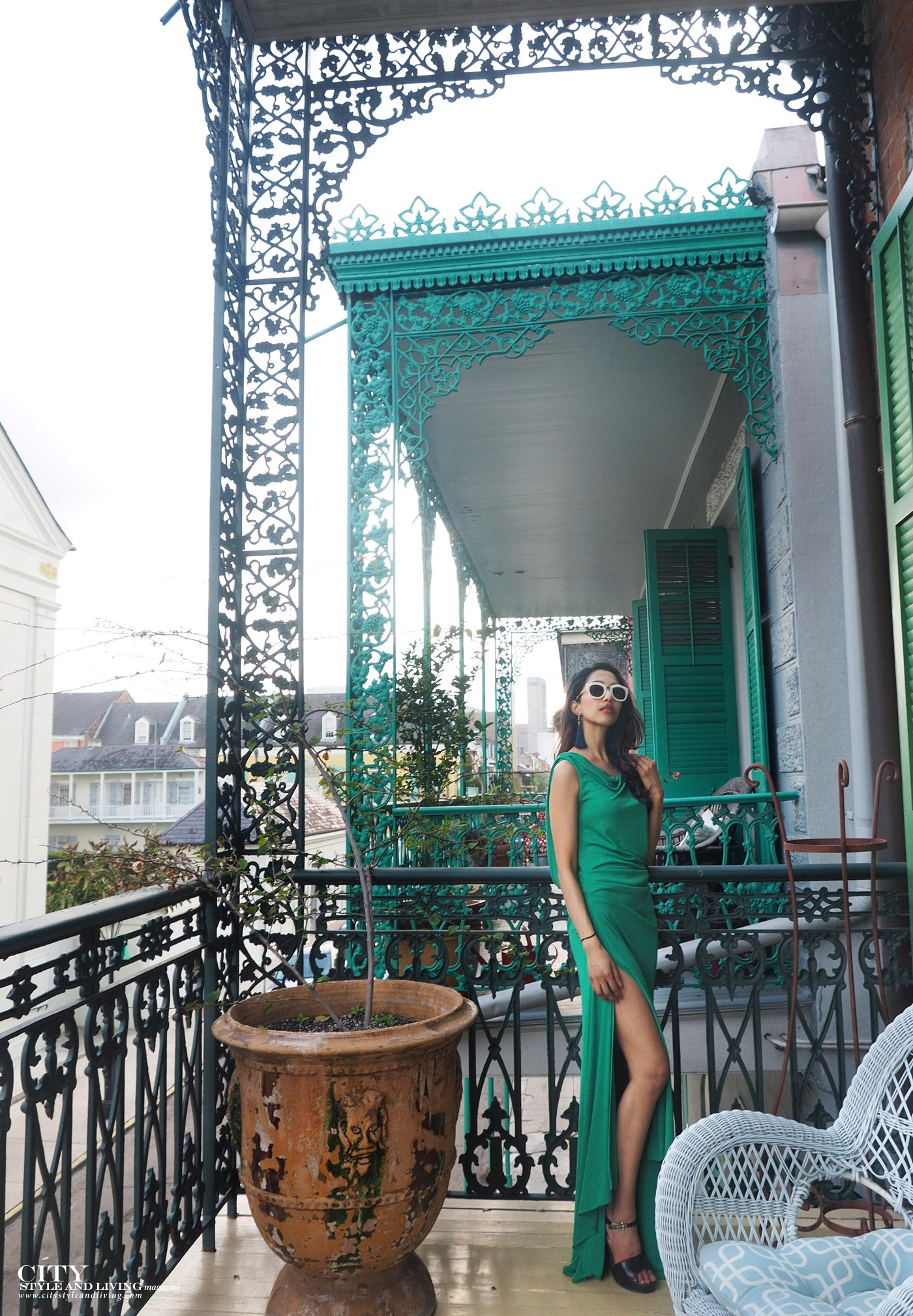 City style and living magazine The Editors Notebook style fashion blogger Shivana Maharaj French Quarter New Orleans Soniat House Balcony wearing BCBG Max Azria green maxi dress wrought iron architecture