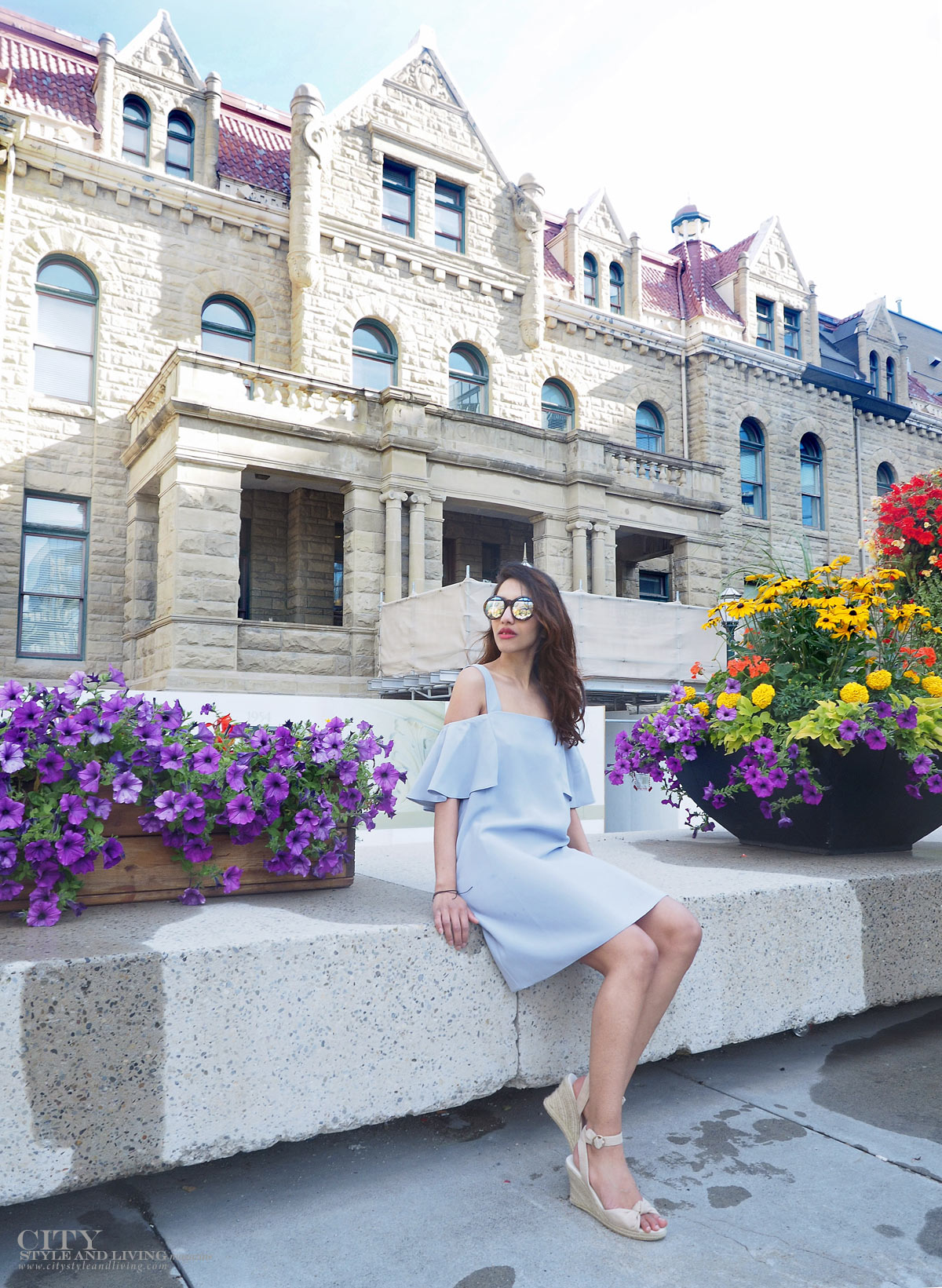 City STyle and Living The Editors Notebook style blogger Downtown Calgary colourful flowers blooming during summer wearing an off shoulder topshop dress and wedges