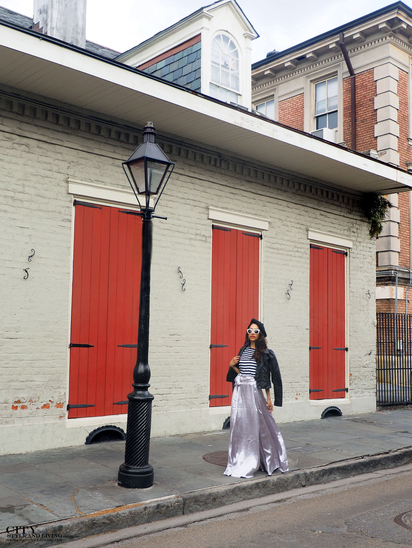 City style and living magazine The Editors Notebook style fashion blogger Shivana Maharaj new orleans french quarter wearing silver skirt french style walking by street lamp