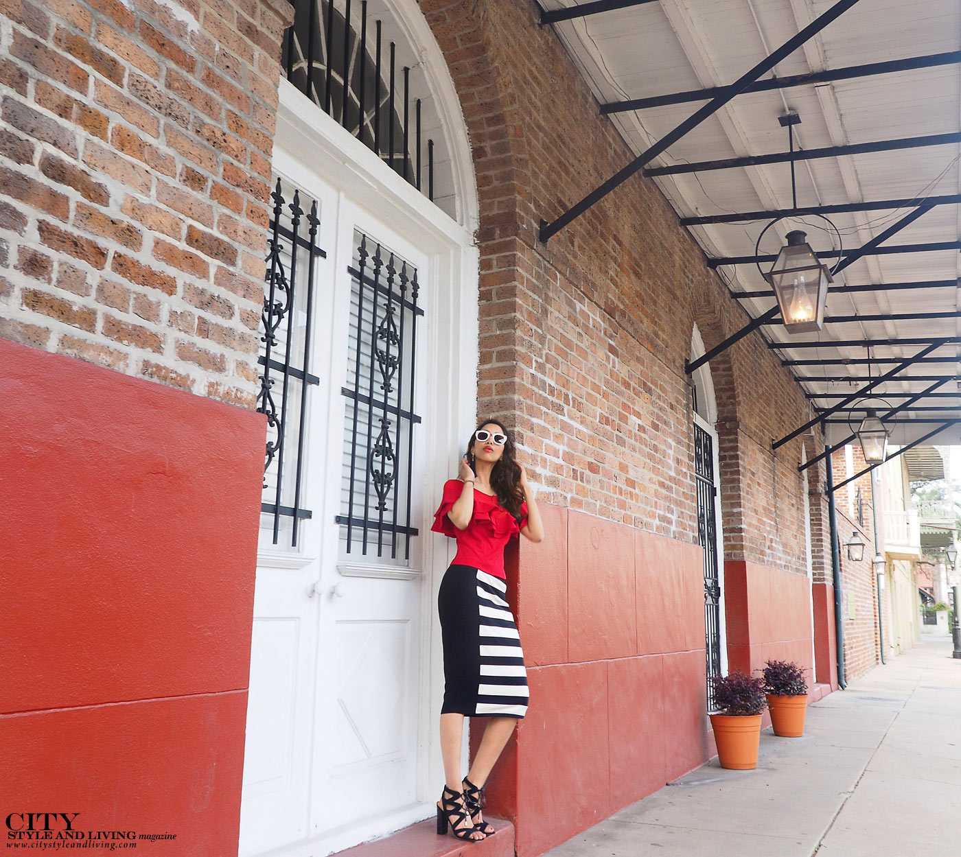 City style and living magazine The Editors Notebook style fashion blogger Shivana Maharaj french quarter new orleans ruffle top and striped skirt architecture closeup
