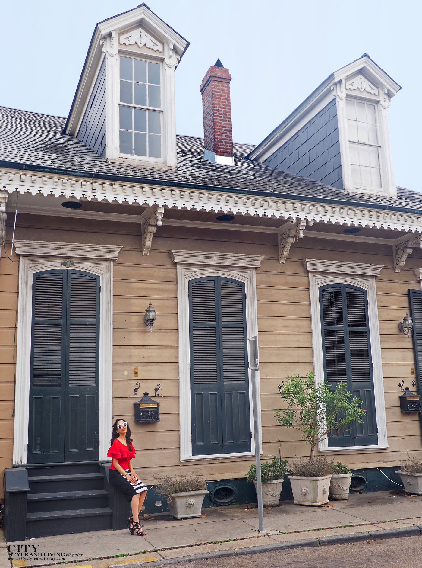 City style and living magazine The Editors Notebook style fashion blogger Shivana Maharaj french quarter new orleans ruffle top and striped skirt architecture shotgun house