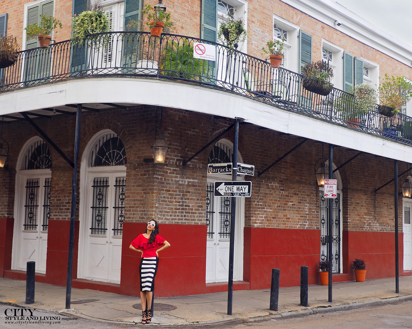 City style and living magazine The Editors Notebook style fashion blogger Shivana Maharaj french quarter new orleans ruffle top and striped skirt street corner architecture