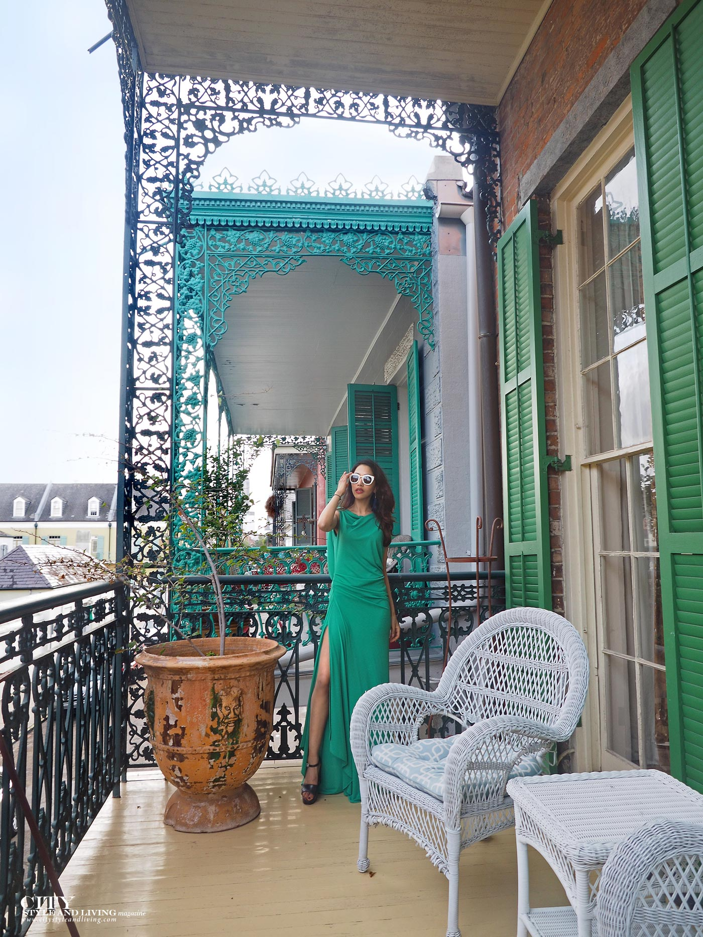 City style and living magazine The Editors Notebook style fashion blogger Shivana Maharaj French Quarter New Orleans Soniat House Balcony wearing BCBG Max Azria green maxi dress