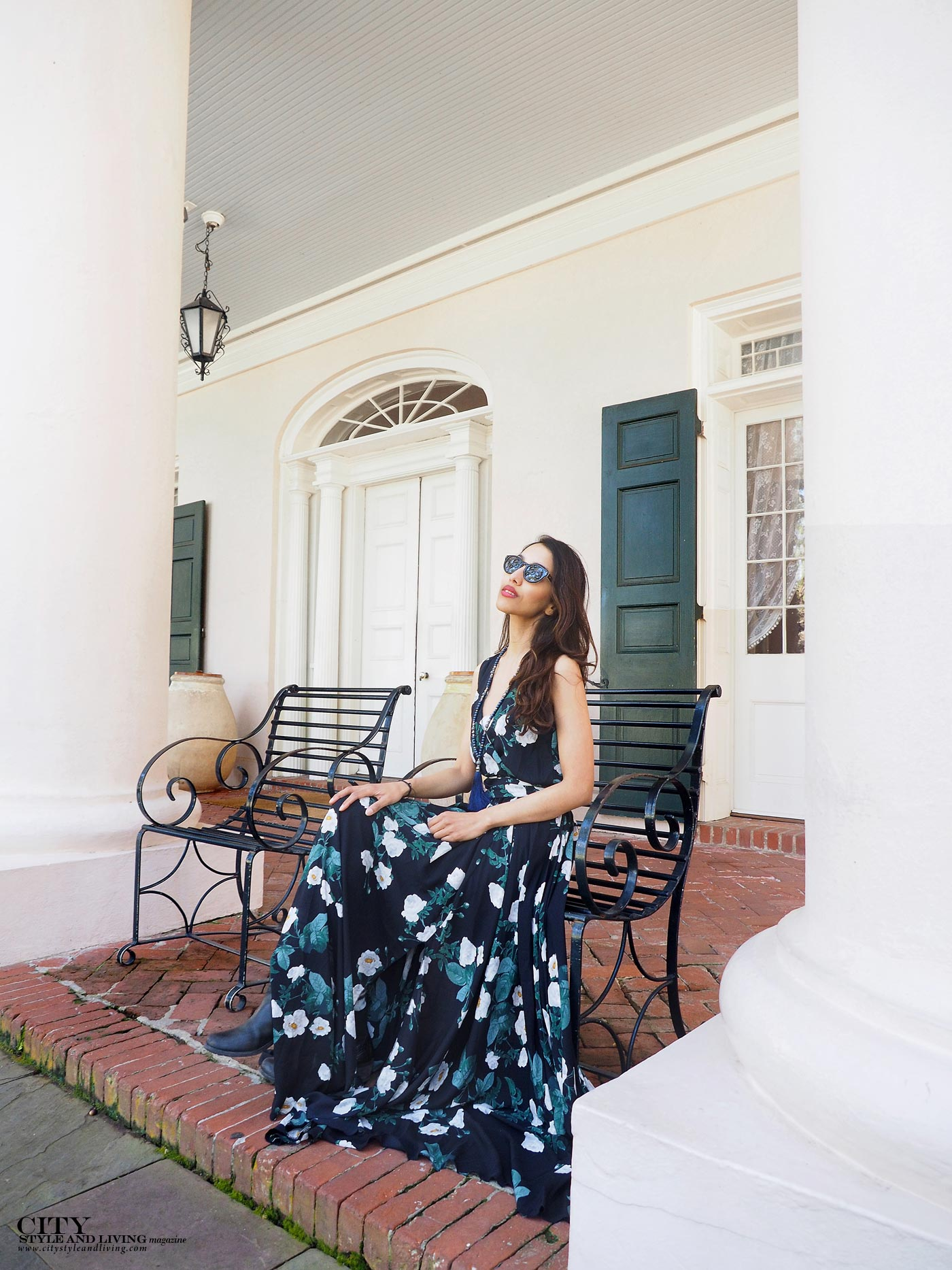 City style and living magazine The Editors Notebook style fashion blogger Shivana Maharaj Oak Alley Plantation maxi dress sitting on porch