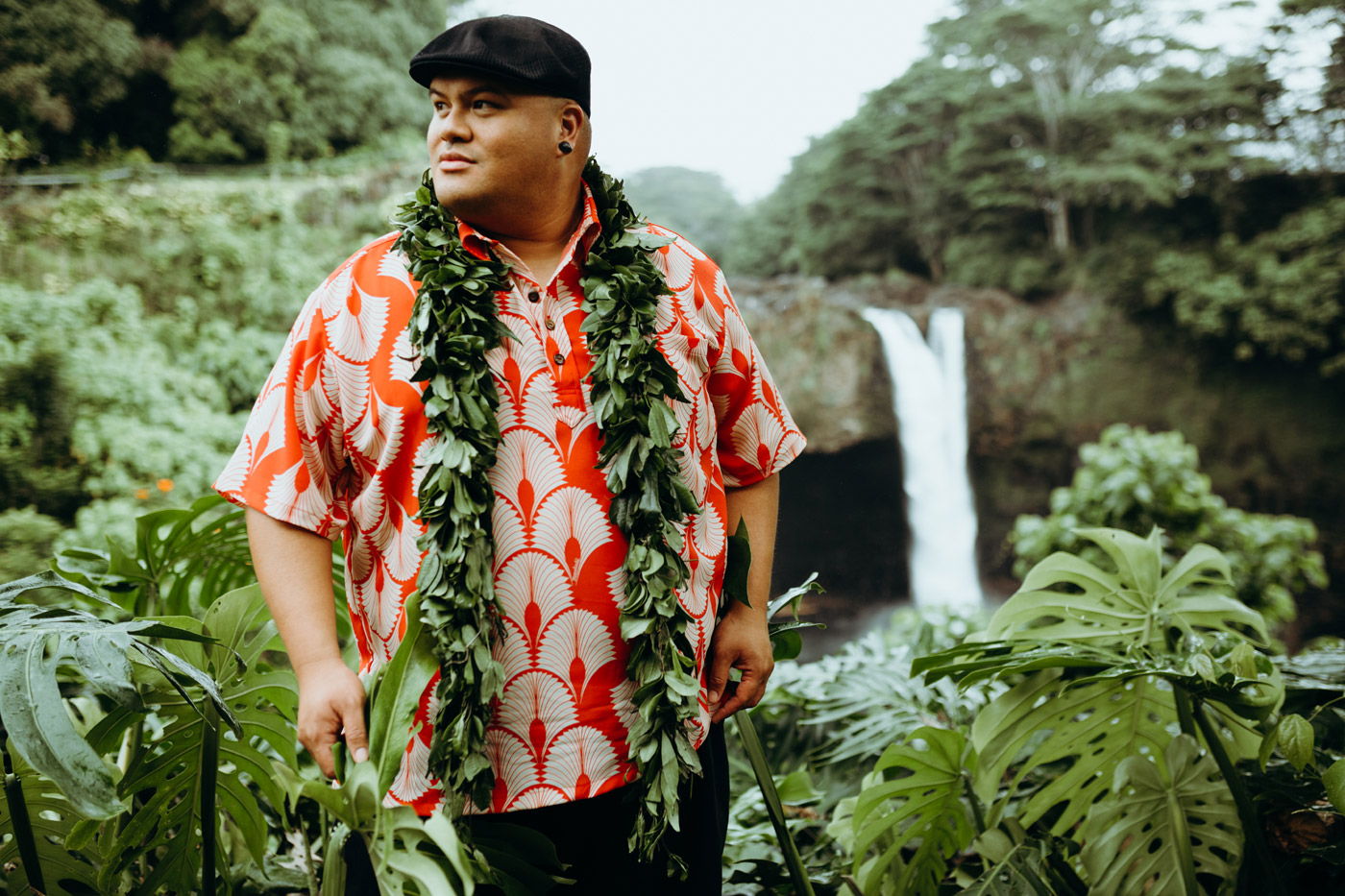 City Style and Living Magazine Spring 2019 Multi-Grammy Award Winner Kalani Pe'a portrait in hawaii with waterfall