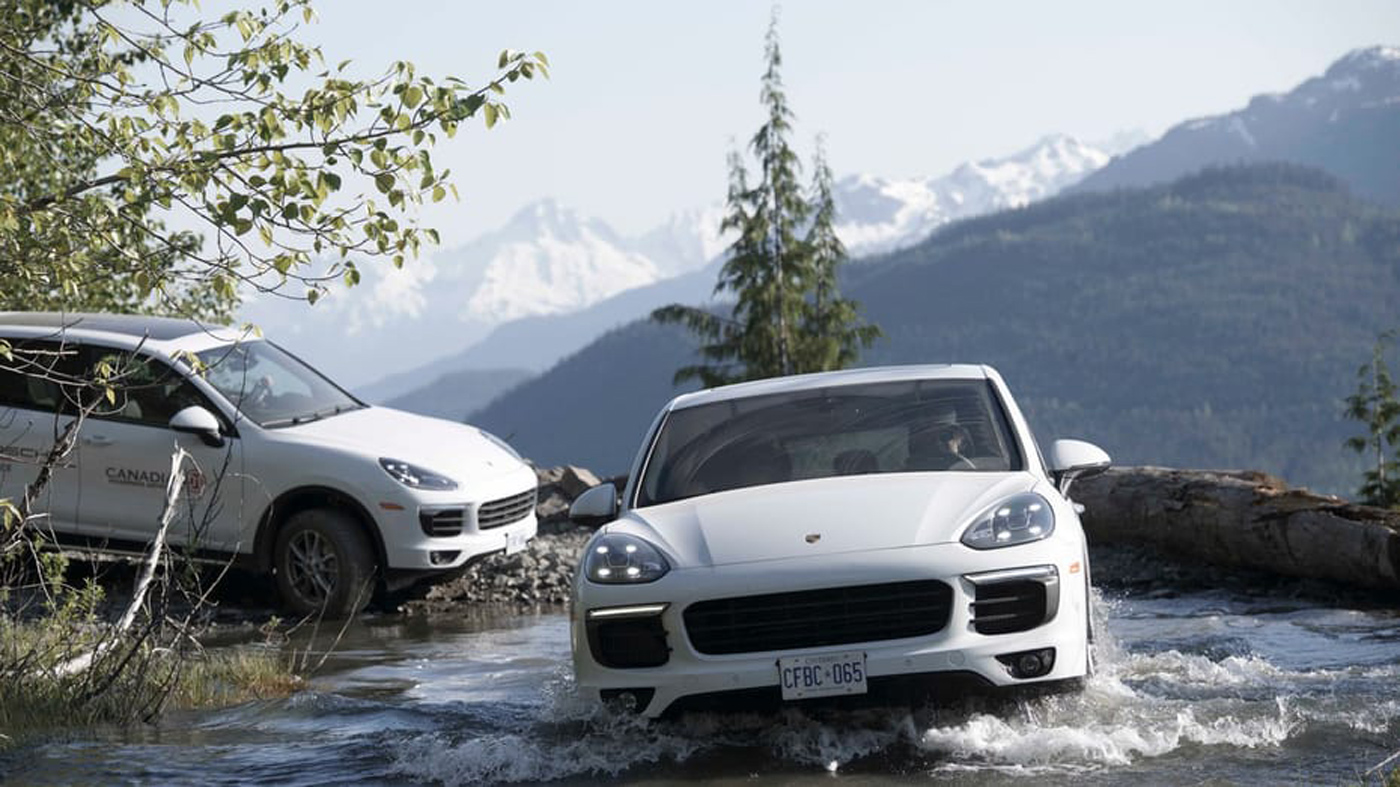 City Style and Living Magazine Summer 2019 Porsche Experience Whistler Cayenne S driving in the creek